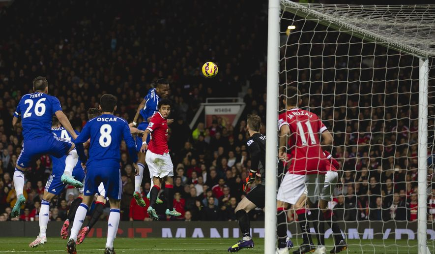 Chelsea's Didier Drogba, upper centre left, scores against Manchester United during the English Premier League soccer match between Manchester United and Chelsea at Old Trafford Stadium, Manchester, England, Sunday Oct. 26, 2014. (AP Photo/Jon Super)