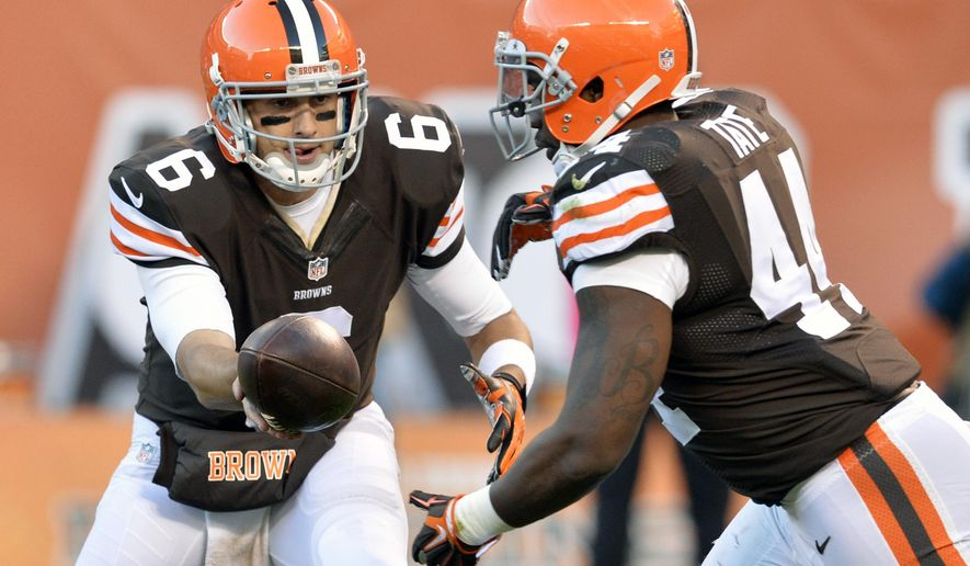 Cleveland Browns quarterback Brian Hoyer (6) hands off to running back Ben Tate (44) in the second quarter of an NFL football game against the Oakland Raiders, Sunday, Oct. 26, 2014, in Cleveland. (AP Photo/David Richard)
