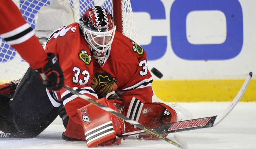 Chicago Blackhawks goalie Scott Darling makes a save during the first period of an NHL hockey game against the Ottawa Senators in Chicago, Sunday, Oct. 26, 2014. (AP Photo/Paul Beaty)