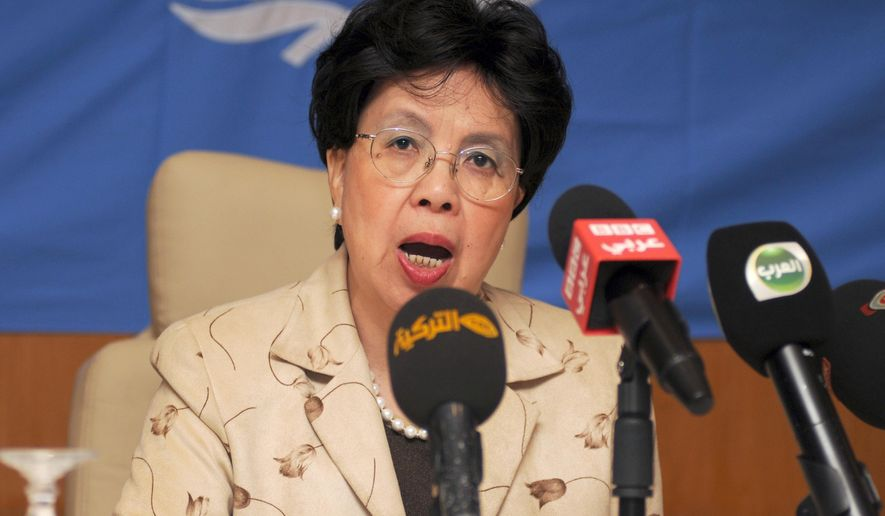 FILE - In this Sunday, Oct. 19, 2014 file photo, Margaret Chan, Director General of the World Health Organization (WHO), addresses the media during a news conference held in an hotel in Gammarth, northeastern Tunisia. Drugmakers are racing to develop vaccines and drugs to address the worst outbreak of Ebola in history. It's unclear who will pay for their products, but companies are betting that governments and aid groups will foot the bill. (AP Photo/Adel Ben Salah, File)