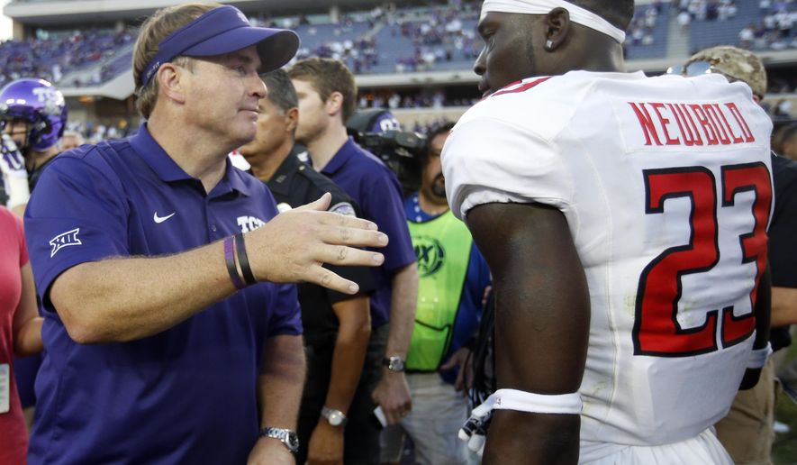 TCU head coach Gary Patterson  talks with Texas Tech defensive back La'Darius Newbold (23) following their NCAA college football game, Saturday, Oct. 25, 2014, in Fort Worth, Texas. TCU won 82-27. (AP Photo/Tony Gutierrez)