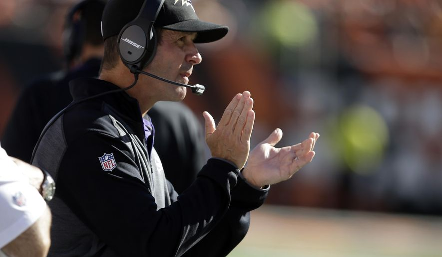 Baltimore Ravens head coach John Harbaugh cheers his team during the second half of an NFL football game against the Cincinnati Bengals in Cincinnati, Sunday, Oct. 26, 2014. (AP Photo/Darron Cummings)