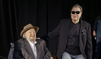 FILE - In this April 22, 2014 file photo, Mac Wiseman, left, and Ronnie Milsap pose after being introduced as two of three new inductees into the Country Music Hall of Fame in Nashville, Tenn. Wiseman and Milsap, along with the late Hank Cochran, will be inducted at a ceremony on Sunday, Oct. 26, in Nashville, Tenn. (AP Photo/Mark Humphrey, File)