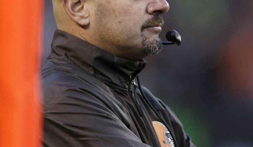Cleveland Browns head coach Mike Pettine watches from the sideline in the third quarter of an NFL football game against the Oakland Raiders, Sunday, Oct. 26, 2014, in Cleveland. (AP Photo/Tony Dejak)