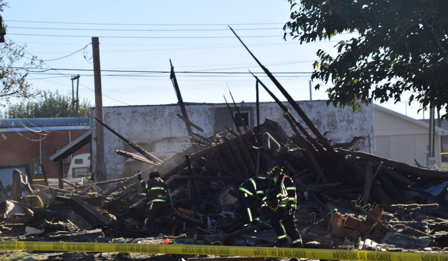In this Saturday, Oct. 25, 2014 photo, firefighters and law enforcement personnel work at the site of an explosion that leveled an apartment building in Borger, Texas. One person was killed and several others suffered minor injuries. (AP Photo/The Amarillo Globe News, JC Cortez)
