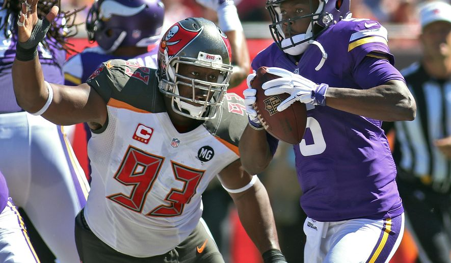Tampa Bay Buccaneers defensive tackle Gerald McCoy (93) pressures Minnesota Vikings quarterback Teddy Bridgewater (5) during the second quarter of an NFL football game Sunday, Oct. 26, 2014, in Tampa, Fla. (AP Photo/Reinhold Matay)