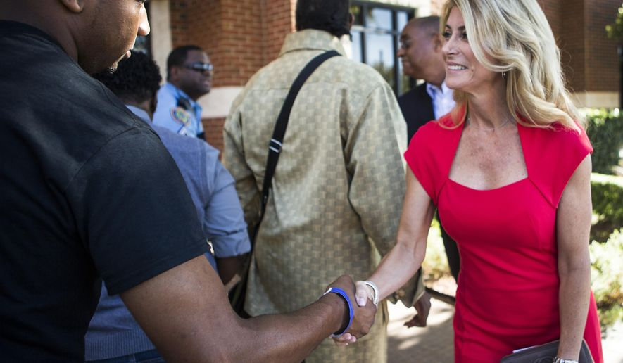 Democratic Texas gubernatorial candidate Wendy Davis greets supporters at St. John's United Methodist Church on Sunday, Oct. 26, 2014, in Houston. Davis is running against Republican Texas Attorney General Greg Abbott in the general election. (AP Photo/Houston Chronicle, Brett Coomer)