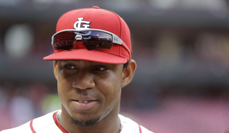 FILE  - This May 31, 2014 file photo shows St. Louis Cardinals' Oscar Taveras smiling after the Cardinals' 2-0 victory over the San Francisco Giants in St. Louis. Authorities say, Sunday, Oct. 26, 2014, Taveras has died in a car accident in the Dominican Republic. (AP Photo/Jeff Roberson, file)