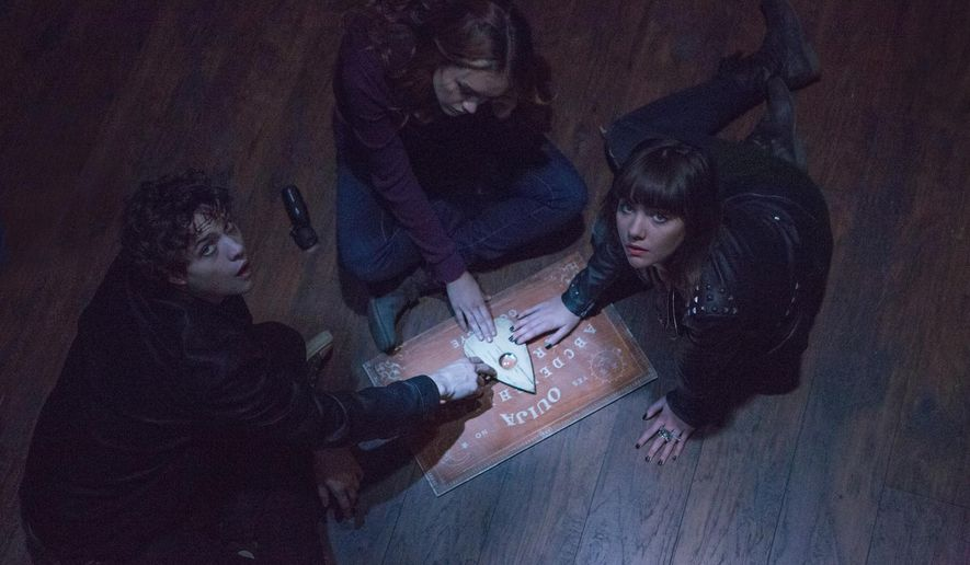 "This photo provided by Universal Pictures shows, from left, Douglas Smith, as Pete, Olivia Cooke, as Laine, and Ana Coto, as Sarah, in ""Ouija."" The spirits moved ""Ouija"" to No. 1 at the box office, with the board-game adaption leading the weekend with a $20 million debut, according to studio estimates Sunday, Oct. 26, 2014. (AP Photo/Universal Pictures, Matt Kennedy)"