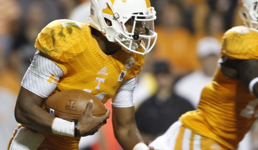 Tennesse quarterback Joshua Dobbs runs the ball against Alabama during the first half of an NCAA college football game Saturday, Oct. 25, 2014, in Knoxville, Tenn. (AP Photo/The Daily Times, Daryl Sullivan)