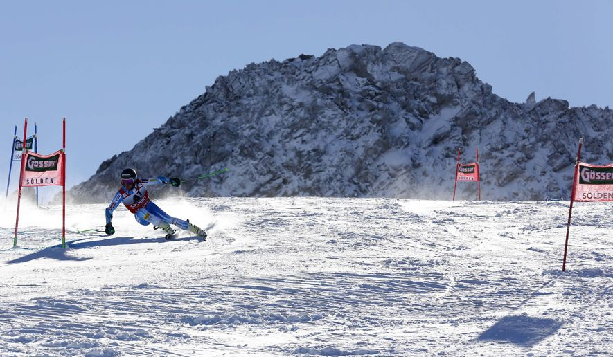 Ted Ligety, of the United States, competes during the first run of an alpine men's World Cup giant slalom in Soelden, Austria, Sunday, Oct. 26, 2014. (AP Photo/Giovanni Auletta)