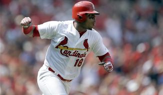 St. Louis Cardinals' Oscar Taveras pumps his fist as he runs down the first base line after hitting an RBI single during the seventh inning of a baseball game against the Milwaukee Brewers Sunday, Aug. 3, 2014, in St. Louis. (AP Photo/Jeff Roberson)