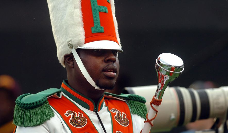 FILE - In this Nov. 19, 2011 file photo, Robert Champion, a drum major in Florida A&M University's Marching 100 band, performs during halftime of a football game in Orlando, Fla. The trial for four band members charged in the hazing death of Champion begins Monday, Oct. 27, 2014 in Orlando, Fla. (AP Photo/The Tampa Tribune, Joseph Brown III, File) SST. PETERSBURG OUT; LAKELAND OUT; BRADENTON OUT; MAGS OUT; LOCAL TV OUT; WTSP CH 10 OUT; WFTS CH 28 OUT; WTVT CH 13 OUT; BAYNEWS 9 OUT