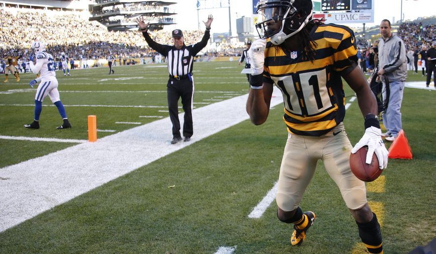 Pittsburgh Steelers wide receiver Markus Wheaton (11) gets up after making a catch as the official signals a touchdown and Indianapolis Colts free safety Darius Butler (20) walks away in the first quarter of an NFL football game, Sunday, Oct. 26, 2014, in Pittsburgh. (AP Photo/Gene Puskar)