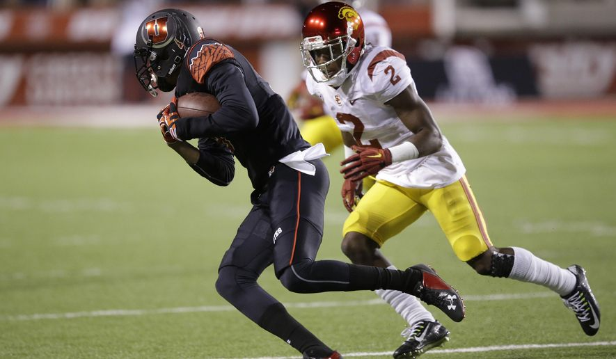 Utah wide receiver Tim Patrick pulls in a catch as Southern California cornerback Adoree' Jackson (2) defends during the first quarter of an NCAA college football game Saturday, Oct. 25, 2014, in Salt Lake City. (AP Photo/Rick Bowmer)
