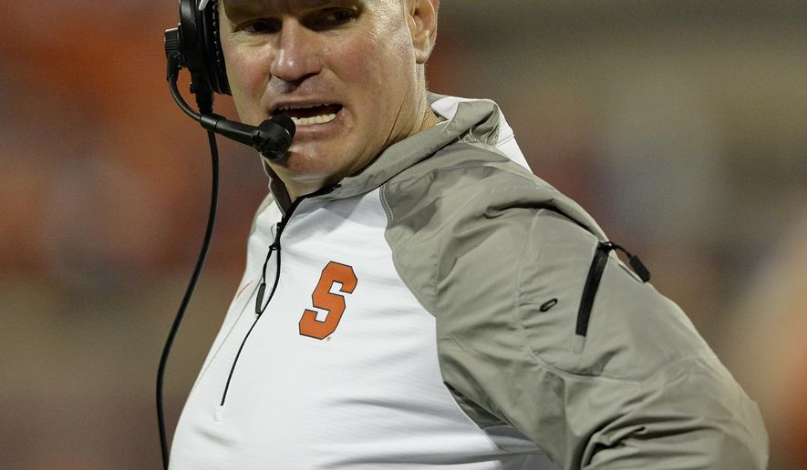 Syracuse head coach Scott Schafer works the sideline during the second half an NCAA college football game against Clemson in Clemson, S.C.,  Saturday, Oct. 25, 2014. (AP Photo/ Richard Shiro)