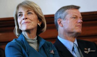 Massachusetts gubernatorial candidates, Democrat Martha Coakley, left, and Republican Charlie Baker sit together while participating in the Greater Boston Interfaith Candidates Forum at Fourth Presbyterian Church in Boston, Sunday, Oct. 26, 2014. (AP Photo/Michael Dwyer)