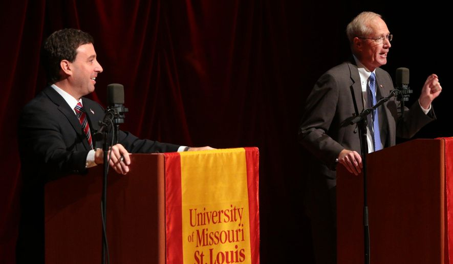 In a Tuesday, Oct. 14, 2014 photo, Democratic County Councilman Steve Stenger , left, and Republican state lawmaker Rick Stream debate issues at the Blanche M. Touhill Performing Arts Center on the campus of the University of Missouri-St. Louis.  (AP Photo/St. Louis Post-Dispatch, Robert Cohen)  EDWARDSVILLE INTELLIGENCER OUT; THE ALTON TELEGRAPH OUT