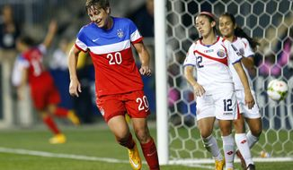 United States forward Abby Wambach (20) reacts after a goal against Costa Rica during the CONCACAF championship soccer match in Chester, Pa., Sunday, Oct. 26, 2014. (AP Photo/Rich Schultz)