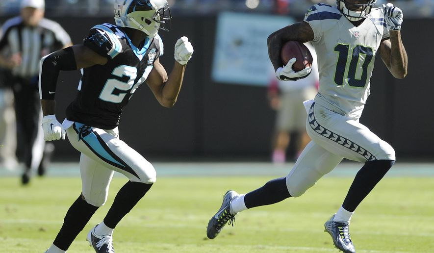 Seattle Seahawks wide receiver Paul Richardson (10) runs against Carolina Panthers cornerback Josh Norman (24) during the first half of an NFL football game, Sunday, Oct. 26, 2014, in Charlotte. (AP Photo/Mike McCarn)