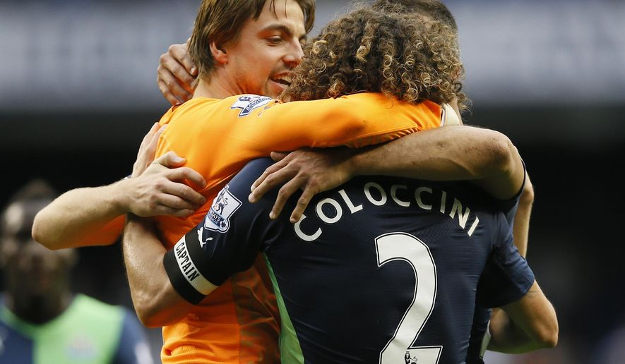 Newcastle's goalkeeper Tim Krul celebrates with Fabricio Coloccini as his side win the English Premier League soccer match between Tottenham Hotspur and Newcastle United at White Hart Lane stadium in London, Sunday, Oct. 26, 2014. (AP Photo/Kirsty Wigglesworth)