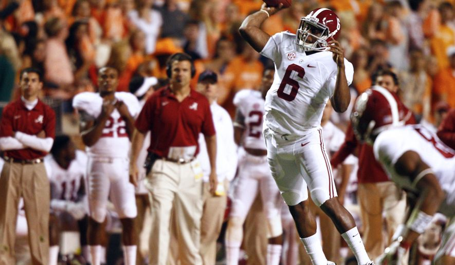 Alabama quarterback Blake Sims (6) throws to a receiver in the first quarter of an NCAA college football game against Tennessee on Saturday, Oct. 25, 2014 in Knoxville, Tenn. Alabama won 34-20. (AP Photo/Wade Payne)