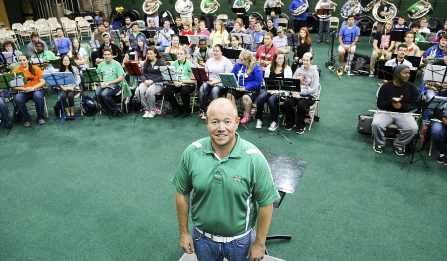 ADVANCE FOR MONDAY OCT 27 AND THEREAFTER This Wednesday Oct. 15, 2014 photo shows Adam Dalton, director of athletic bands at Marshall University, at the Band Complex located in the Cam Henderson Center in Huntington, W.Va. (AP Photo/Sholton Singer)