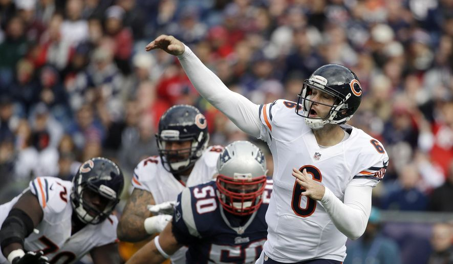 Chicago Bears quarterback Jay Cutler (6) passes in front of a rush by New England Patriots defensive end Rob Ninkovich (50) in the first half of an NFL football game on Sunday, Oct. 26, 2014, in Foxborough, Mass. (AP Photo/Steven Senne)