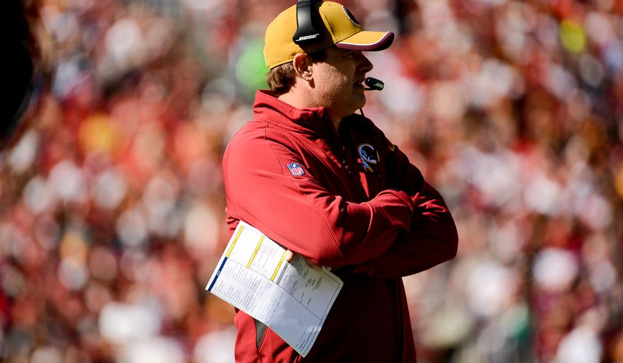 Washington Redskins head coach Jay Gruden watches game action in the first quarter as the Washington Redskins play the Tennessee Titans at FedEx Field, Landover, Md., Sunday, October 19, 2014. (Andrew Harnik/The Washington Times)