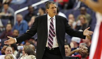Washington Wizards head coach Randy Wittman questions an officials' call in the first half of a pre-season NBA basketball game against the Charlotte Hornets, Friday, Oct. 17, 2014 in Washington. (AP Photo/Alex Brandon)