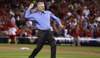 St. Louis Cardinals broadcaster Tim McCarver throws the ceremonial first pitch before Game 3 of baseball's NL Division Series between the St. Louis Cardinals and the Los Angeles Dodgers, Monday, Oct. 6, 2014, in St. Louis. (AP Photo/Charles Rex Arbogast)