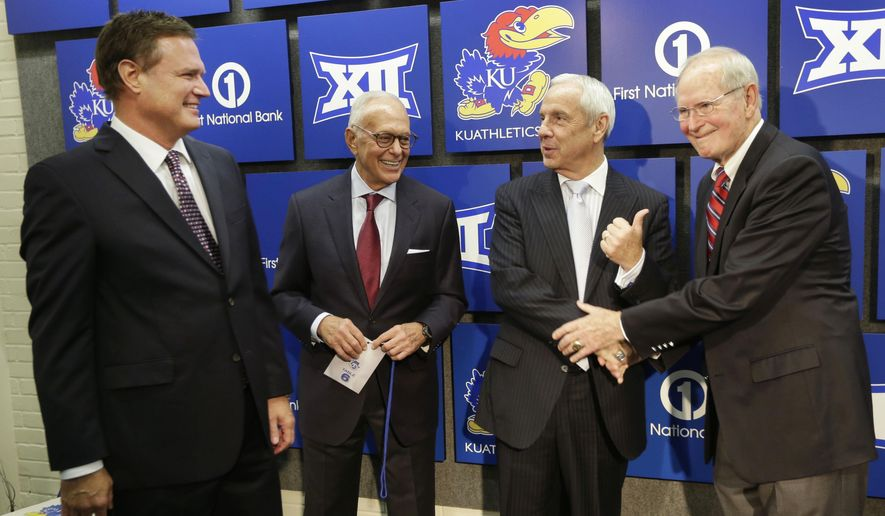 Kansas basketball coach Bill Self, from left, talks with former Kansas coaches Larry Brown, Roy Williams and Ted Owens following a news conference for the 60th anniversary of Allen Fieldhouse in Lawrence, Kan., Monday, Oct. 27, 2014. (AP Photo/Orlin Wagner)