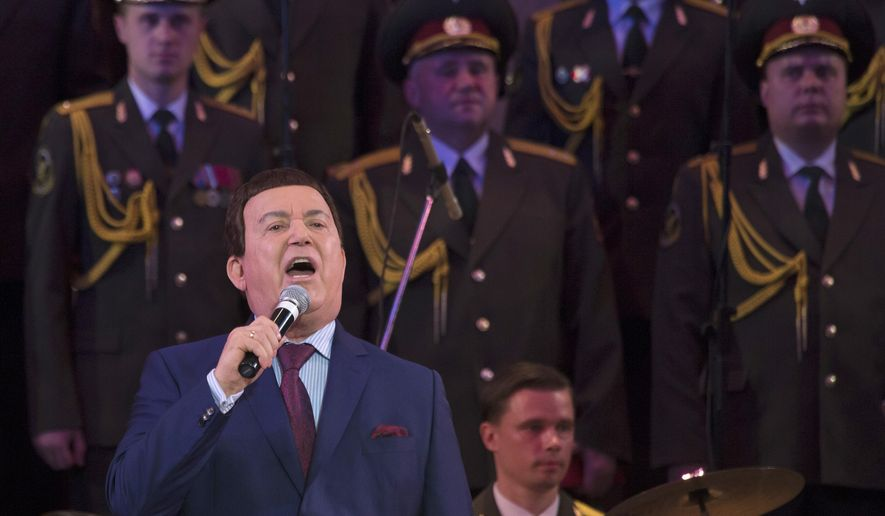 Russian singer Iosif Kobzon, sings during during his concert in the town of Donetsk, eastern Ukraine Monday, Oct. 27, 2014. Defying an entry ban, an iconic Soviet crooner performed in a rebel stronghold in eastern Ukraine, praising the separatists for fighting the Ukrainian government. Ukraine last week warned 77-year-old Iosif Kobzon, arguably the most revered Russian singer and lawmaker who has publicly supported the pro-Russian separatists, that he would be banned from entering the country if he tried to. (AP Photo/Dmitry Lovetsky)