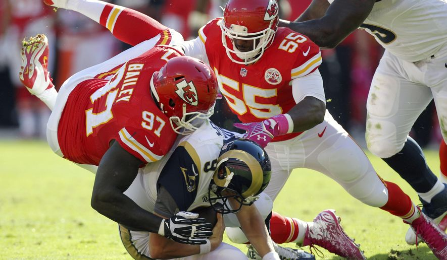 St. Louis Rams quarterback Austin Davis (9) is sacked by Kansas City Chiefs defensive end Allen Bailey (97) and linebacker Dee Ford (55) in the second half of an NFL football game in Kansas City, Mo., Sunday, Oct. 26, 2014. (AP Photo/Ed Zurga)