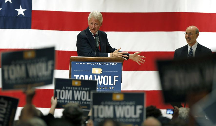 Former President Bill Clinton, left, talks about Democratic party candidate for governor Tom Wolf , right, as he endorses Wolf in the upcoming election against Republican Governor Tom Corbett on Monday, Oct. 27, 2014, in Pittsburgh. (AP Photo/Keith Srakocic)