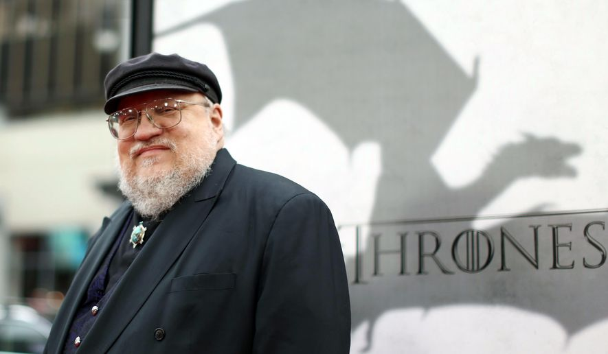 "FILE - In this March 18, 2013 file photo, author George R.R. Martin arrives at the premiere for the third season of the HBO television series ""Game of Thrones"" at the TCL Chinese Theatre in Los Angeles. ""The World of Ice & Fire: The Untold History of Westeros and the Game of Thrones,"" a companion volume to Martin's ""Ice and Fire"" series, will be released Tuesday, Oct. 28, 2014. (Photo by Matt Sayles /Invision/AP, File)"