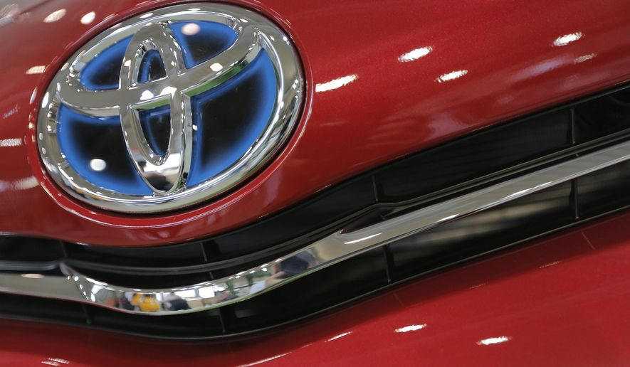 FILE - This Aug. 2, 2013 file photo shows the emblem of a Toyota car at Toyota Mega Web in Tokyo. Toyota continues its winning streak atop Consumer Reports' annual reliability survey, released Monday, Oct. 27, 2014. (AP Photo/Itsuo Inouye, File)