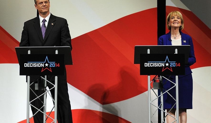 The two leading candidates for governor, Republican Charles D. Baker Jr. and Democrat Martha M. Coakley, square off at The Hanover Theatre for the Performing Arts Monday, Oct. 27, 2014, in the city's first gubernatorial debate in 12 years. (AP Photo/Worcester Telegram & Gazette, Dan Gould)