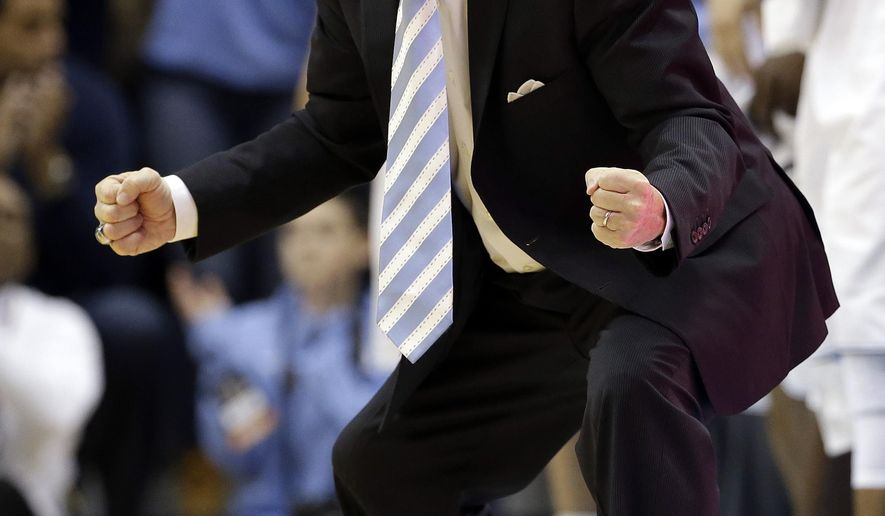 FILE - In this Monday, March 3, 2014 photo, North Carolina coach Roy Williams reacts during the second half of an NCAA college basketball game against Notre Dame in Chapel Hill, N.C. (AP Photo/Gerry Broome)