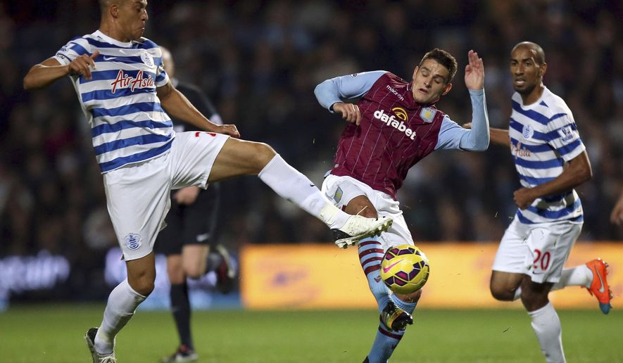 Queens Park Rangers' Bobby Zamora, left, and Aston Villa's Ashley Westwood in action during the English Premier League soccer match at Loftus Road in London, Monday Oct. 27, 2014. (AP Photo / John Walton, PA) UNITED KINGDOM OUT - NO SALES - NO ARCHIVES