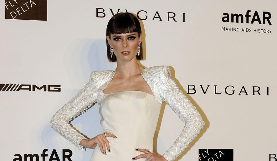 "FILE - In this Sept. 20, 2014 file photo, supermodel Coco Rocha arrives for the amfAR charity dinner during the fashion week in Milan, Italy. Rocha managed to come up with 1,000 different poses for a new coffee table book, ""Study of Pose,"" which hits stores Tuesday, Oct. 28, 2014. (AP Photo/Giuseppe Aresu, File)"