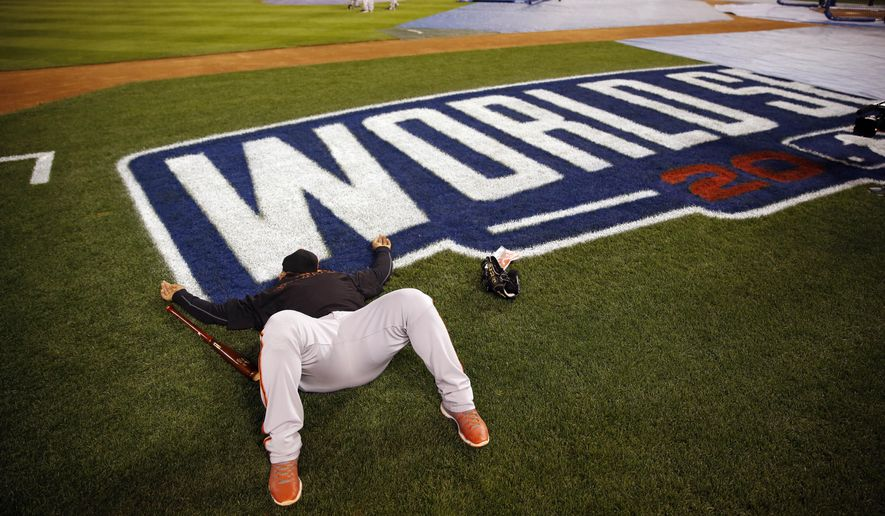 San Francisco Giants third baseman Pablo Sandoval lays down shortly after arriving at Kauffman Stadium for a workout Monday, Oct. 27, 2014, in Kansas City, Mo. The Giants and Kansas City Royals are scheduled to play Game 6 of baseball's World Series on Tuesday. (AP Photo/Jeff Roberson)