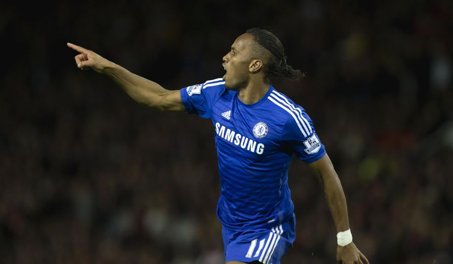 Chelsea's Didier Drogba celebrates after scoring against Manchester United during the English Premier League soccer match between Manchester United and Chelsea at Old Trafford Stadium, Manchester, England, Sunday Oct. 26, 2014. (AP Photo/Jon Super)