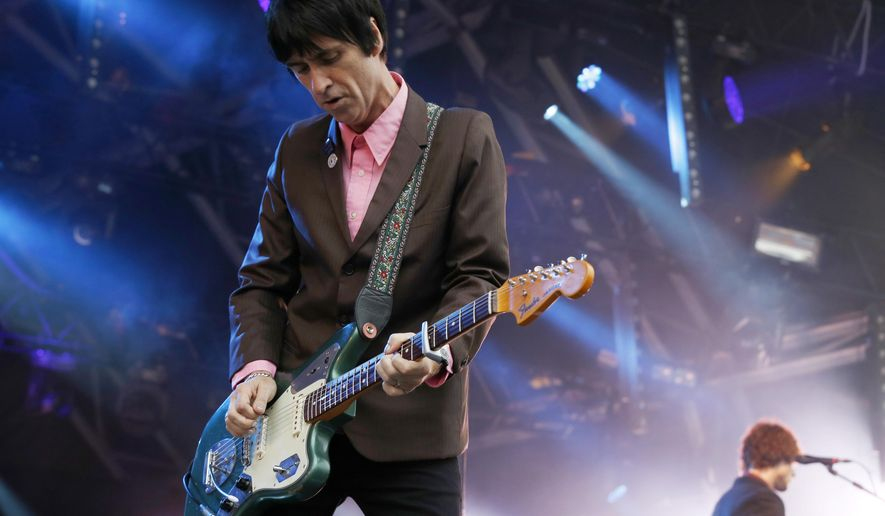 "FILE - In this Aug. 1, 2014 file photo, British singer Johnny Marr performs at Camp Bestival at Lulworth Castle in Dorset, England.The former guitarist for The Smiths has just released his second solo album, ""Playland,"" a follow-up to well-received 2013 effort ""The Messenger."" Both offer robust, richly textured guitar rock _ the latest of Marr's many musical modes.  (Photo by Jim Ross/Invision/AP, File)"