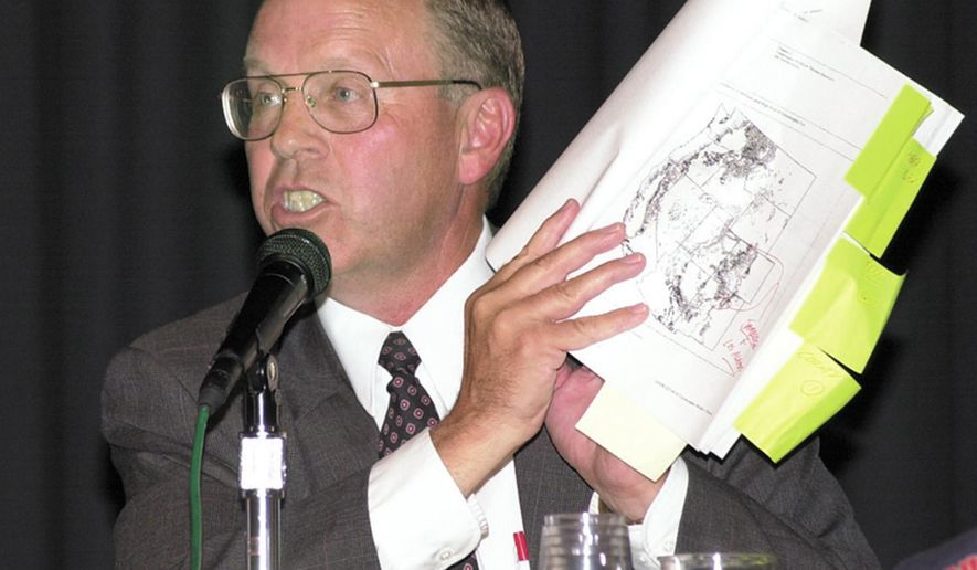 In this 2000 file photo, Grant Gerber holds a map of the Jarbidge, Nevada area during a panel in Elko, Nevada.  Gerber, a longtime lawyer and conservative political activist, died Saturday Oct. 25, 2014, from injuries he suffered when he fell off a horse in Kansas while protesting a federal crackdown on livestock grazing.  (AP/Photo, Elko Daily Free Press, Ross Andreson).