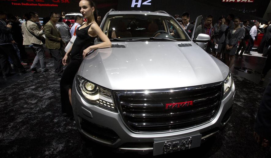 FILE - In this April 20, 2014 file photo, a model poses near Chinese SUV maker Great Wall Motors' Haval 8 at the China Auto show held in Beijing. Analysts expect China to be the biggest market for SUVs in the world by 2018. (AP Photo/Ng Han Guan, File)