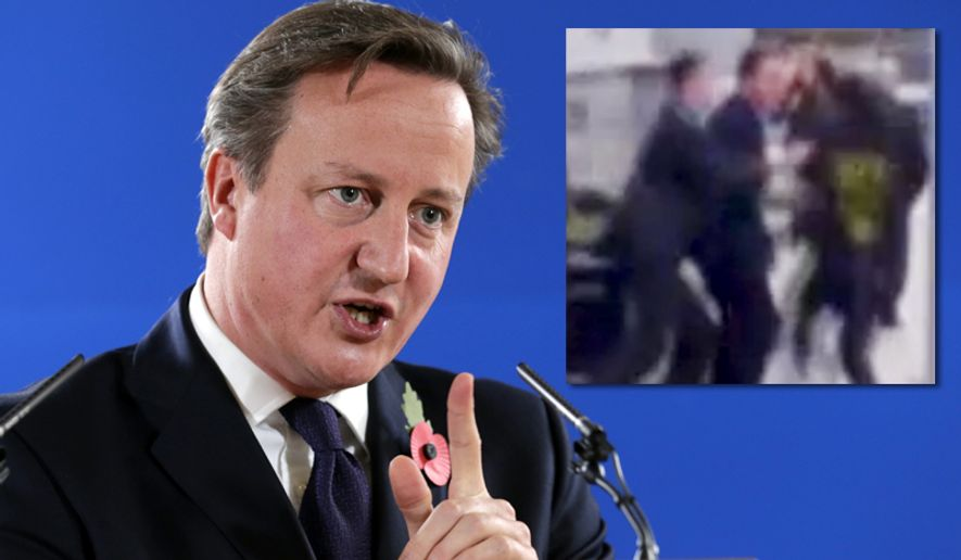 A man runs into British Prime Minister David Cameron on visit to Leeds. ** FILE **