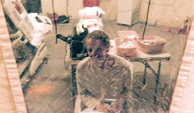 Nurse Kaci Hickox was placed into an isolation tent at University Hospital in Newark, New Jersey, where she was quarantined after flying into Newark Liberty International Airport following her work in West Africa caring for Ebola patients. (AP Photo/Steven Hyman)
