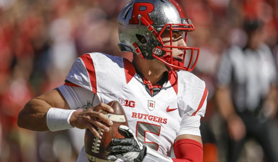 Rutgers quarterback Chris Laviano (5) looks to pass in the second half of an NCAA college football game against Nebraska in Lincoln, Neb., Saturday, Oct. 25, 2014. Nebraska won 42-24. (AP Photo/Nati Harnik)