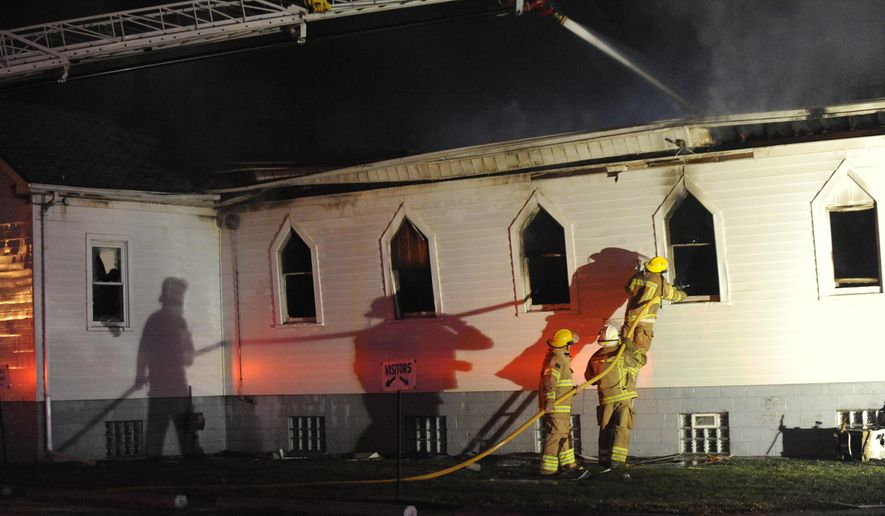 Firefighters work to control a fire at Redeemer United Methodist Church Thrift Shop in Harper Woods, Mich., on Monday, Oct. 27, 2014. The fire gutted the church building. The cause of the fire is under investigation.  (AP Photo/Detroit News, David Coates)  DETROIT FREE PRESS OUT; HUFFINGTON POST OUT